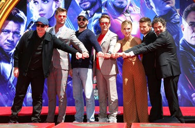 """Marvel Studios President Kevin Feige, from left, poses with members of the cast of """"Avengers: End Game,"""" Chris Hemsworth, Chris Evans, Robert Downey Jr., Scarlett Johansson, Jeremy Renner and Mark Ruffalo at a hand and footprint ceremony at the TCL Chines"""