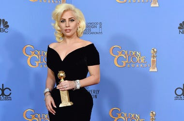 """Lady Gaga poses in the press room with the award for best performance by an actress in a limited series or a motion picture made for TV for """"American Horror Story: Hotel"""""""