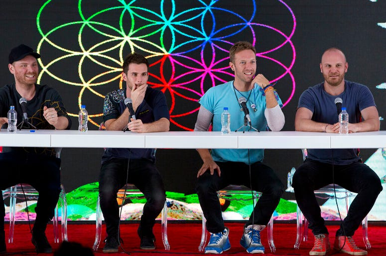 Coldplay, from left, Jonny Buckland, Guy Berryman, Chris Martin, and Will Champion, participate in a press conference at Foro Sol in Mexico City.