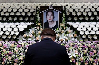 A South Korean man pays tribute to K-pop star Goo Hara at a memorial altar at the Seoul St. Mary's Hospital in Seoul, Monday, Nov. 25, 2019. Hara was found dead at her home in Seoul on Sunday, police said.