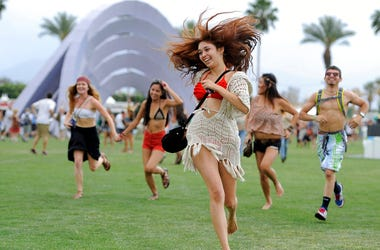 festivalgoers running toward the main stage at the 2012 Coachella Valley Music and Arts Festival in Indio, Calif.