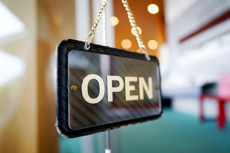 Open sign in business window
