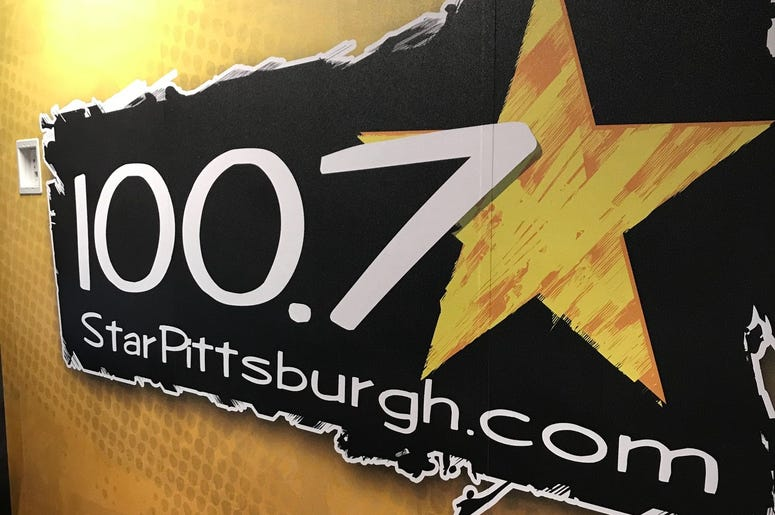 """Outside view of 100.7 Star's storefront """"studio"""" in BizTown"""