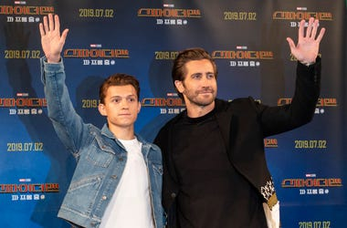 "Actors Tom Holland (L) and Jake Gyllenhaal greet fans during a promotion activity of the film ""Spider-Man: Far From Home"""