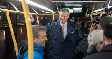 Bill de Blasio on a bus