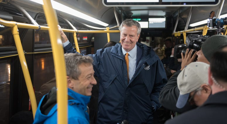 Bill de Blasio on a bus
