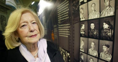 FILE - In this Jan. 27, 2004 file photo, Holcaust survivor Gena Turgel poses for a photo, in London.