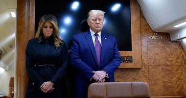 President Donald Trump and first lady Melania Trump moment of silence
