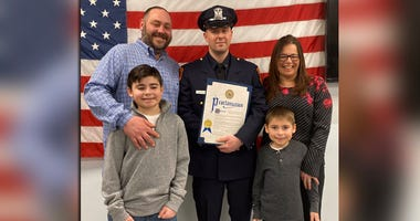 Officer Avital Donnenfeld with the Hoffman family
