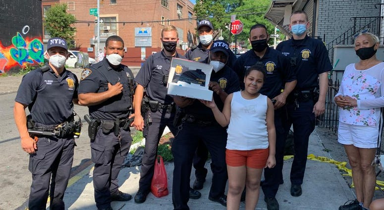 Girl gets birthday cake from NYPD
