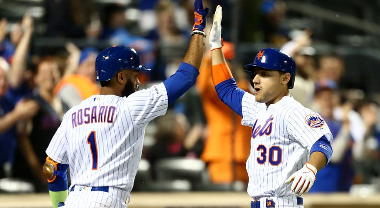 Michael Conforto and Ahmed Rosario