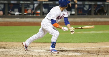 Michael Conforto #30 of the New York Mets drives in two runs in the eighth inning with a double against the New York Yankees during their game at Citi Field on July 02, 2019