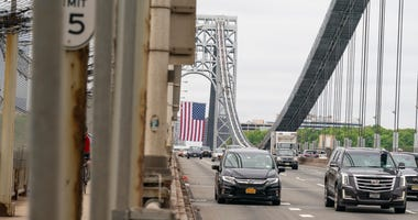 View of roadways of George Washington Bridge with huge American Flag hanging on New Jersey side tower during Memorial Day in NYC amid COVID-19 pandemic.