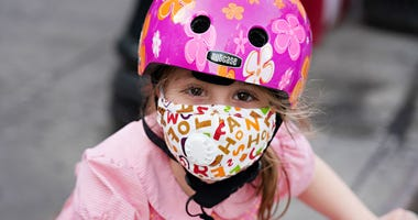 NYC coronavirus - child in mask
