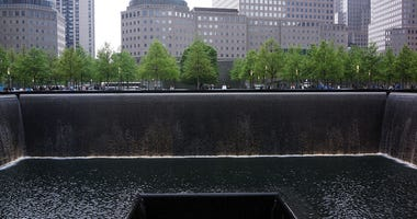 The South reflecting pool is viewed at the Ground Zero memorial site during the dedication ceremony of the National September 11 Memorial Museum in New York May 15, 2014 in New York City.