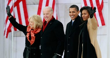"""President-elect Barack Obama (2R), his wife Michelle Obama (R) and Vice President-elect Joseph Biden (2L) and his wife Jill Biden wave after arriving at """"We Are One: The Obama Inaugural Celebration At The Lincoln Memorial"""" January 18, 2009 in Washington"""