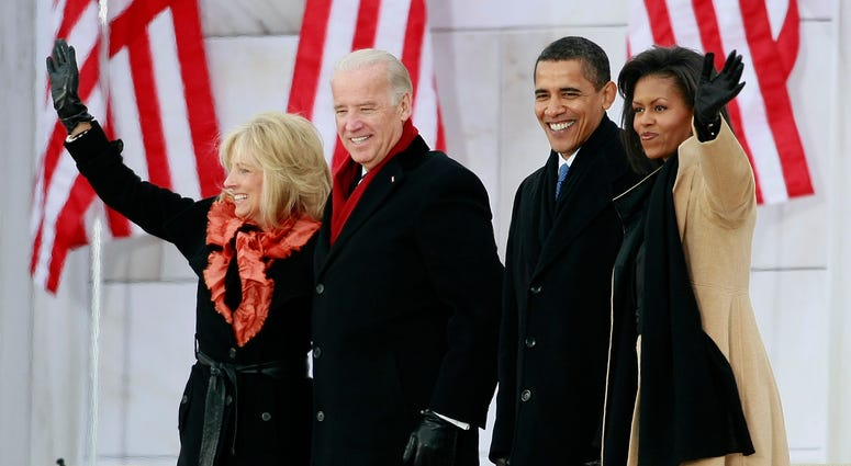"President-elect Barack Obama (2R), his wife Michelle Obama (R) and Vice President-elect Joseph Biden (2L) and his wife Jill Biden wave after arriving at ""We Are One: The Obama Inaugural Celebration At The Lincoln Memorial"" January 18, 2009 in Washington"