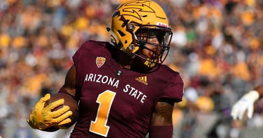 N'Keal Harry makes a grab for Arizona State during a game in 2018.