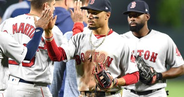 Mookie Betts and the Boston Red Sox celebrate a win over the Baltimore Orioles on May 7, 2019.