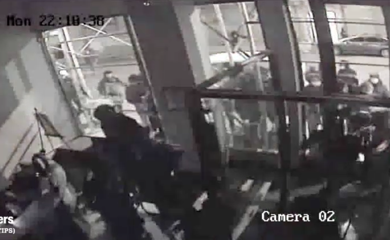 The fur store being burglarized