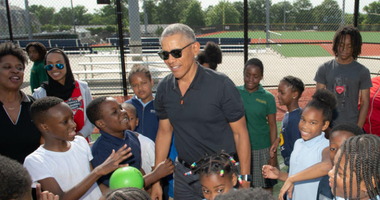 President Barack Obama speaks with children at the Nationals Youth Academy.