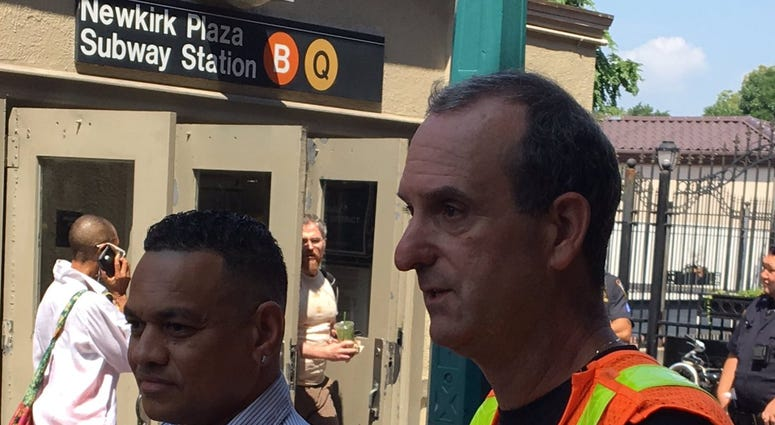 Two MTA employees save a woman