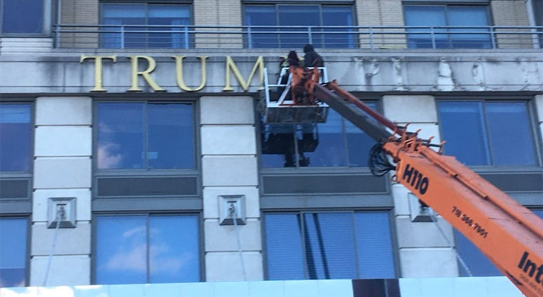 Trump Place Sign Removal