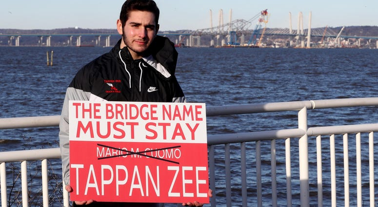 David Dunlop, 17, of Tappan has created a sign that has become popular among those who hope to change the name of the Gov. Mario M. Cuomo Bridge back to the Tappan Zee Bridge.