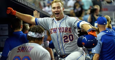 New York Mets first baseman Pete Alonso (20) celebrates in the dugout after hitting a three run homer in the ninth inning against the Miami Marlins at Marlins Park.