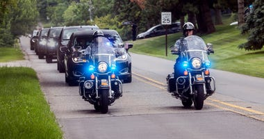 Police escort funeral procession