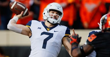 Will Grier throws a pass for West Virginia in a 2018 game against Oklahoma State.