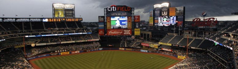 Clouds move in over Citi Field during a Mets game.