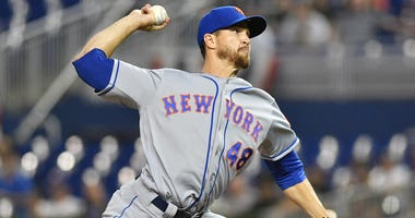 Jacob deGrom of the New York Mets delivers a pitch against the Miami Marlins