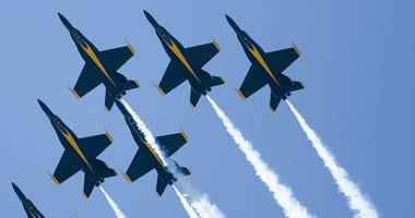 The Blue Angels fly in formation during an air show.