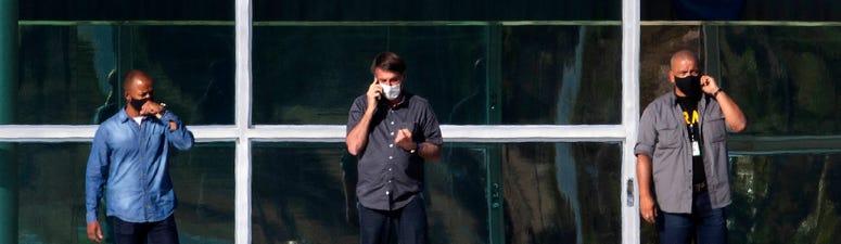Video calls, separate bedrooms: Bolsonaro's first COVID week