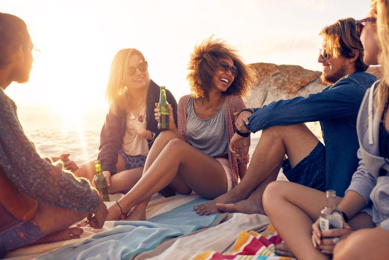 A group of friends enjoy the beach.