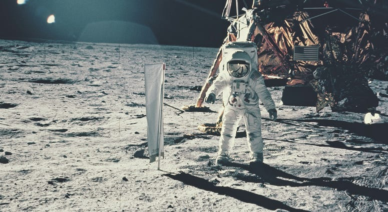 Edwin 'Buzz' Aldrin standing next to the Solar Wind Composition experiment