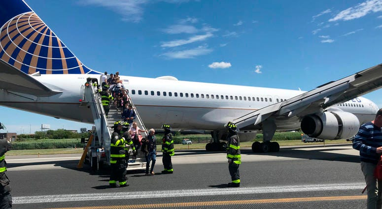 Plane skids on runway Newark Airport