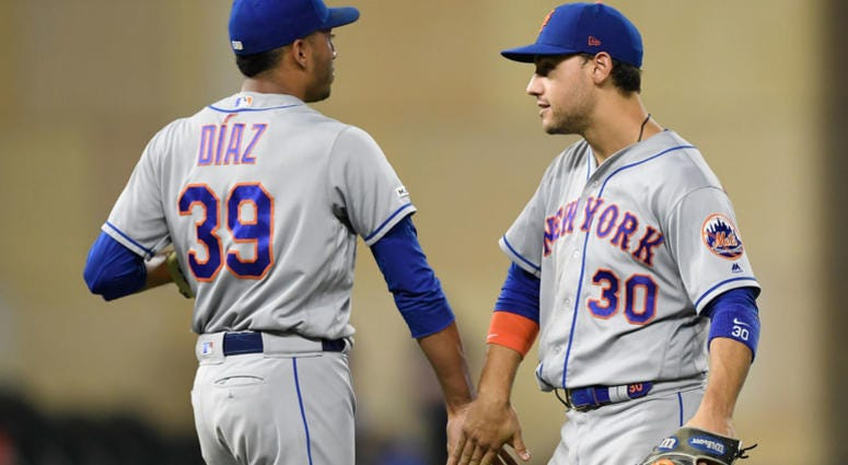 Edwin Diaz #39 and Michael Conforto #30 of the New York Mets celebrate defeating the Minnesota Twins after the interleague game on July 16, 2019 at Target Field in Minneapolis, Minnesota.