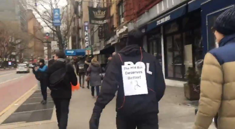 Advocates race M14 bus on 14th street in East Village