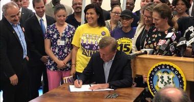 Ned Lamont signs minimum wage bill