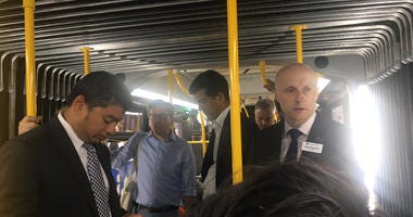 Andy Byford rides bus