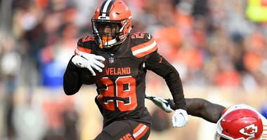 Duke Johnson of the Cleveland Browns avoids a tackle by Allen Bailey of the Kansas City Chiefs during an NFL game in 2018.