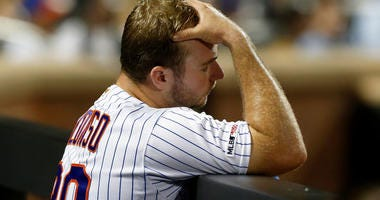 Pete Alonso #20 of the New York Mets looks on from the dugout during the seventh inning against the Miami Marlins at Citi Field on September 23, 2019