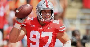 Nick Bosa of Ohio State recovers a fumble during a game in 2018.