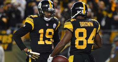 JuJu Smith-Schuster celebrates with former Pittsburgh Steelers teammate Antonio Brown.