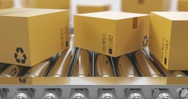Recycled packaging on conveyor belt