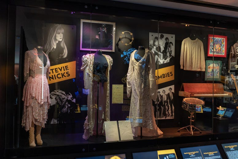 """Stevie Nicks outfits including the dress from her """"The Sorcerer"""" music video and other items on display."""