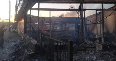 Destroyed building protests
