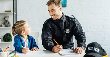 Police and kid stock photo